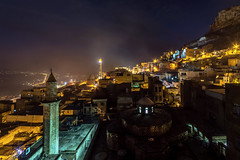 Mardin in night (Nejdet Duzen) Tags: old travel urban mountain history tourism rock stone architecture night turkey town sand ancient place traditional famous hill trkiye culture style landmark scene arabic east mardin gece camii turkei seyahat gneydou