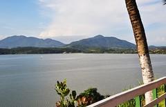 sailing alone... (Ruby Ferreira ) Tags: lake fence boat barco branches hills brasile montanhas saquaremarj crca brasilemimagens