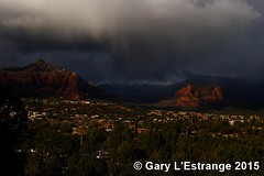 Sedona Airport Road overlook as cloud rolls across the buttes (garylestrangephotography) Tags: road red vacation arizona usa cloud mountain holiday storm tree weather clouds landscape grey airport scenery butte bad scenic sedona roadtrip vista redrock overlook stormyweather garylestrangephotography