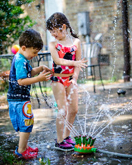 DSCF0701 (djandzoya) Tags: water backyard play sam candid siblings sprinkler fujifilm provia fenya