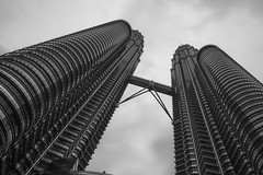 Looking up at Petronas Towers (CreArtPhoto.ro) Tags: blackandwhite abstract up architecture clouds petronas kualalumpur sus petronasmalayesia