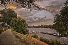 Evening at Alte Donau (A.B. Art) Tags: vienna wien road trees postprocessed water colors clouds austria evening abend wasser cloudy wolken bume weg farben wolkig abart nachbearbeitet altedonau starburst911
