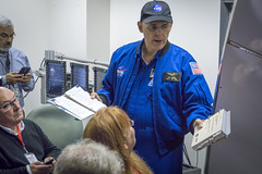Astronaut Lee Morin showing us the 250 Pounds of Flight Data Manuals for Shuttle