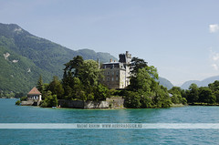 Lake Annecy, France (Naomi Rahim (thanks for 2 million hits)) Tags: travel summer mountain lake france mountains alps building castle annecy water architecture clouds town nikon europa europe frenchalps lacdannecy hautesavoie travelphotography rhnealpes lakeannecy nikond7000