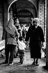 coup d'oeil   Penang, Malaysia   2014 (ChinkybuNini) Tags: street family people urban blackandwhite bw man canon asia poetry poem child haiku photos walk mother streetphotography son malaysia penang poems bnw streetphotos urbanphotography 500d photohaiku 2015 streetexpedition