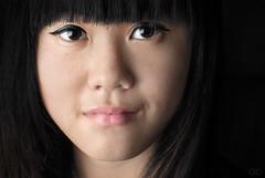 Ngoc Mai (bollwahn) Tags: portrait berlin contrast asian eyes focus headshot vietnam asiangirl closeupcloseup portraitheadshotfocuscloseupcloseupcontrasteyesc exhibitionunterwegs
