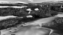 follow the icy flow (lunaryuna) Tags: longexposure bridge bw panorama water monochrome river season landscape blackwhite iceland spring solitude rockface le godafoss rivercanyon seasonalchange myvatnregion riverskjlfandafljt lunaryun centralnorthiceland
