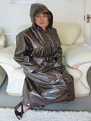 black mac sat on settee (smmack) Tags: black mac shiny hooded