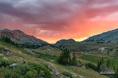 Paint Rock Valley Sunset (kevin-palmer) Tags: cloudpeakwilderness bighornmountains bighornnationalforest wyoming summer july backpacking paintrockvalley pine trees storm stormy red orange clouds nikond750 tamron2470mmf28 evening sunset elkmountain