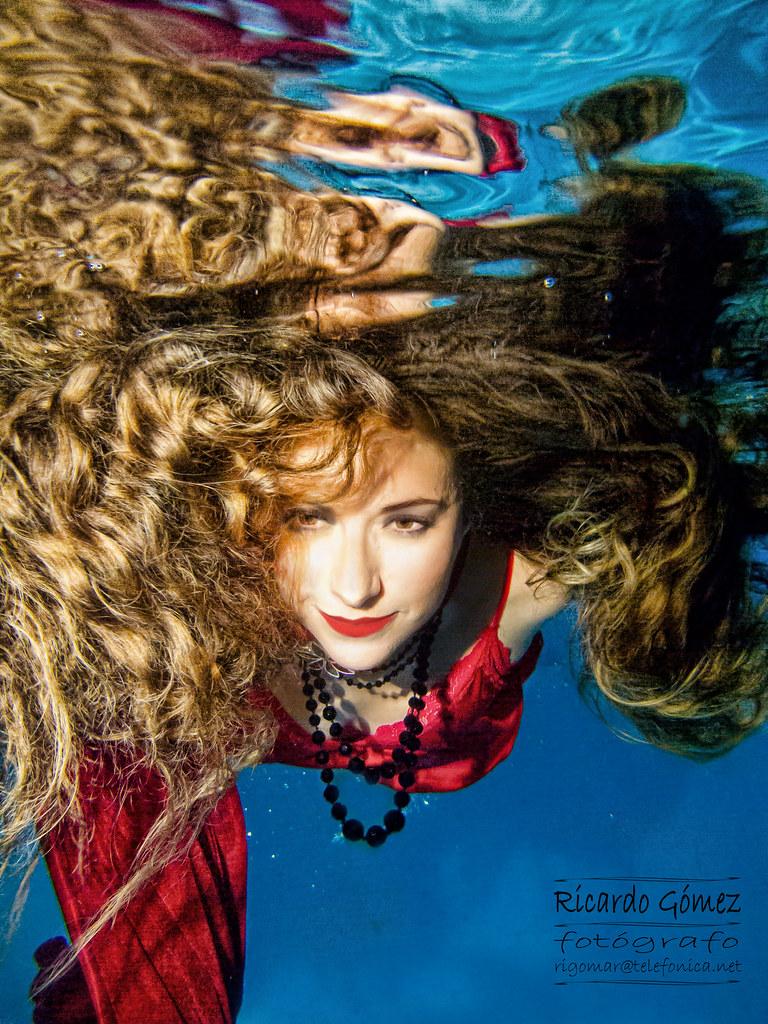 Underwater vintage woman consider