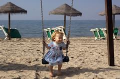 Emily on the Swings (dan.oxlade) Tags: swings nikon d40 nikkor nikkor50mm118g travel beach girl toddler