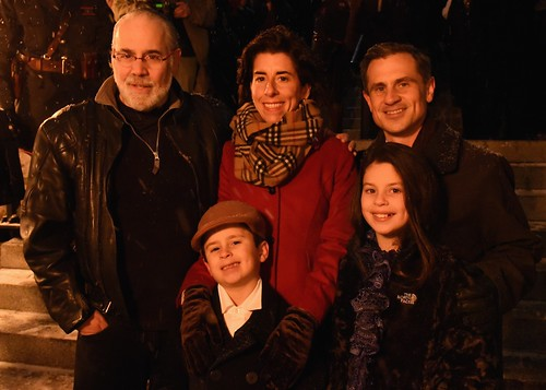 WaterFire creator Barnaby Evans poses with Governor Gina Raimondo, her husband Andy Moffit, son Tommy, and daughter Ceci. Photo by Elaine Fredrick.