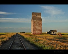 Sentinel of Cereal (Gordon Hunter) Tags: life red sky canada abandoned pool train evening box elevator grain cereal tracks railway storage bin silo gordon hunter sk prairie saskatchewan dankin