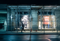 going out / going home (ekonon) Tags: street streets night published scaffolding manhattan shopwindow