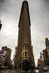 The Flatiron (SaltyDogPhoto) Tags: city nyc newyorkcity longexposure travel urban ny newyork motion streets building tourism wet rain weather sign architecture photography nikon cloudy manhattan exploring sightseeing angles landmark rainy nikkor flatironbuilding flatiron lowangle photooftheday urbanphotography 2016 ndfilter urbangeometry lowpov nikonphotography nikond7200 saltydogphoto nikkor1680mmf284eedvr