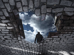 entering cloursphere (marianna - away for a while) Tags: street city blue sky urban canada reflection men clouds escape montreal cobblestones oldmontreal exit mariannaarmata