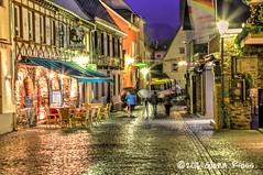 Rudesheim-070401 (glennrossimages) Tags: urban rain germany de lights hessen cobblestones rainy umbrellas rüdesheimamrhein