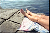 (Red Heat) (Robbie McIntosh) Tags: leicamp leica mp rangefinder streetphotography 35mm film pellicola analog analogue negative leicam analogico dyi selfdeveloped filmisnotdead autaut candid tetenalcolortecc41 strangers cinestill50d cinestill 50 summilux leicasummilux35mmf14i summilux35mmf14i leicasummilux35mmf14 summilux35mmf14preasph pose portrait beach summer sea woman colonnaspezzata feet toenails red legs