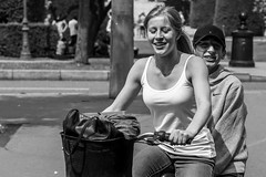 Smile in duo... (Periades) Tags: street blackandwhite bw smile bike bicycle blackwhite noiretblanc streetphotography nb human cap casquette fille sourire vlo photoderue streethuman steethuman