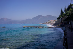 Bay view day (aleksey_kondratiev) Tags: turkey fethiye oludeniz mediterranean sea water blue wave waves seashore rocks sky pier rust mountain beach