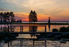 Tranquility (Peggy Skof) Tags: park bridge trees sun ontario canada nature water windmill colors river outside golden pond nikon colours path ottawa goldenhour andrewhaydenpark nikond5200
