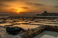Warm Sunrise (glank27) Tags: seascape beach sunrise canon landscape eos rocks mediterranean malta efs gozo saltpans f3556 70d xwejni 1585mm ilqolla