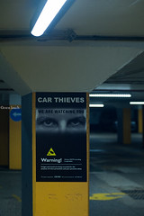 Tom Cruise is Watching You (Sven's extras (sven loach)) Tags: uk england london sign angel warning underground poster 50mm lights britain surveillance watch streetphotography cctv security spooky crime tomcruise flourescent robbery carpark theft dystopian orwellian carthieves d700