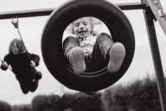 Joy! (Dalla*) Tags: boy portrait white black boys kids joy swing tireswing swinging wwwdallais