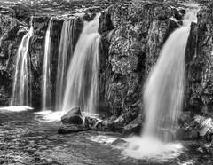 Iceland Kirkjufoss a waterfall in black and white (Nick L) Tags: blackandwhite bw canon waterfall iceland kirkjufoss snaefellspeninsula eos5dmarkiii 5d3 kirkjufellfoss canon5d3 canon5dmark3 eos5dmkiii canon2470li latierraunparaiso