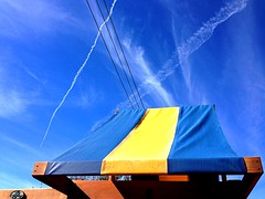 The Christmas Sky 2 (Cesar's iPhoneography) Tags: christmas xmas blue sky lines yellow clouds backyard day texas suburban cloudy stripes suburbia houston bluesky diagonal powerlines wires streaks skyward pearland junglegym iphoneography