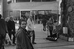 Busking in Pricesshay (pigpogm) Tags: street people blackandwhite musician music woman monochrome photos guitar exeter busker princesshay guitarist unprocessed leicaelmar90f4 leica90f4 mxpp