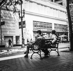 Urban Spectators (TMimages PDX) Tags: road street city people urban blackandwhite monochrome buildings portland geotagged photography photo image streetphotography streetscene sidewalk photograph pedestrians pacificnorthwest avenue vignette fineartphotography iphoneography