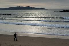 Walking (CeliaQuintillan) Tags: ocean sunset costa beach atardecer coast mar sand playa arena galicia ocaso pontevedra atlntico ogrove alanzada galifornia