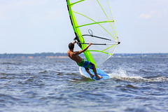 Rear view of young windsurfer (SANGUINET TOURISME - JAZZ IN SANGUINET) Tags: ocean sea summer vacation sky sun man nature wet water sport speed flying athletic cool freestyle surf waves power wind action surfer board horizon extreme surfing surfboard sail windsurfing leisure recreation activity splash windsurfer active windsurf russianfederation