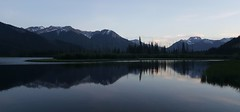 Vermilion lake at sunset (Anne Oldfield) Tags: lake alberta canada mountains dusk vermilionlake tranquil peaceful beautiful love water nature tree snow summer vacation roadtrip reflection reflections scenery