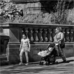 Am I going to be like Mom one day? (John Riper) Tags: street uk england bw baby white black monochrome tattoo liverpool canon john square photography mono zwartwit candid daughter mother l contemplating 6d 24105 straatfotografie riper johnriper