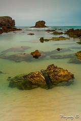 Rocks on the beach tor (Baquez) Tags: espaa beach landscape spain asturias playa paisaje toro llanes largaexposicion baquez yanlb yanlopezbaquez