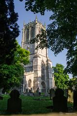 St Mary's Church Tickhill 0452 (Paul C Cooper) Tags: saint mary church grave yard stine tree sunset sun light shadow tower steeple grass sky blue green