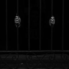 """Trying to escape from herself"" (Laura Moraa) Tags: hands manos woman mujer blackandwhite blancoynegro jail rejas encierro artistico locked ansiedad anxiety"