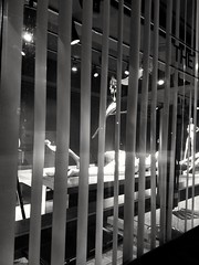 fantasy seen thru the blinds (williamw60640) Tags: art sculpture humanfigures gallery window woman blinds venetianblinds windowcoverings nightscape fantasy dream view alteredreality imagination dominatrix domination tracklighting showing look 8thdaygallery galleryspace dominatrice