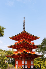 Close-up of Kiyomizu-dera buddist temple pagoda in Kyoto (basair) Tags: red japaneseculture pagoda kiyomizuderatemple templebuilding shrine kyotocity traveldestinations outdoors kyotoprefecture japan eastasia asia architecture famousplace buildingexterior buildingactivity buddhism religion cultures classic sky multicolored builtstructure eastasianculture formalgarden parkmanmadespace gate dera niomon locallandmark internationallandmark nationallandmark unescoworldheritagesite springtime ancient nopeople april placeofworship horizontal colorimage entrance spirituality tranquilscene woodmaterial roof tile tower clear copyspace