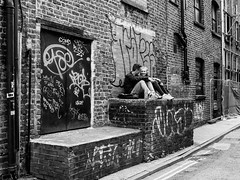 Northern Quarter #116 (Peter.Bartlett) Tags: manchester bag backpiccadilly unitedkingdom city graffiti door lunaphoto girl candid uk m43 couple bw wall fence noiretblanc people facade doorway drainpipe woman doubleyellowlines urban window urbanarte niksilverefex man microfourthirds streetphotography sitting olympuspenf sign blackandwhite monochrome peterbartlett