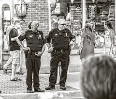 Men in Blue...... (Kevin Povenz Thanks for the 2,600,000 views) Tags: 2016 june kevinpovenz westmichigan michigan ottawa ottawacounty holland hollandstreetperformers police officer blackandwhite bw men canon7dmarkii streetphotography candid street monochrome