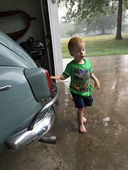 playing in the rain (blue65pv544) Tags: grand son children boy father poppy thunderstorm rain garage volvo pv544