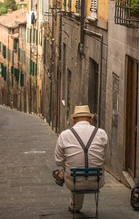 Artist (ptshaw) Tags: red street artist people painter tuscany sienna houses hat