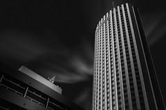 Fais la mouette (blondmao) Tags: france hyattregencyparisetoile building bnw clouds lepalaisdescongrsdeparis skyscraper paris dark architecture hotel blackandwhite sky bw