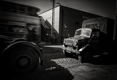 . . . armytruck (orangecapri) Tags: orangecapri vintage lorry mod army ww2 bw blur blurred movement vehicle oldlorry classic auto museum ancient tram people monochrome old vignette carshow autoshow crich building driver wheels moving shadows windshield tyres inexplore explore explored