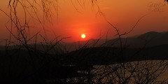 Red Sky Delight (Glenda Hall) Tags: africa sunset red sun holiday mountains silhouette canon southafrica branches silhouettes september layers redsky distance twigs glenda kwazulunatal 2014 zuluvillage shakaland canon60d glendahall
