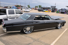 Mesquite - Custom Chevrolet Impala (1965) (Drriss & Marrionn) Tags: habitatautomotiveshow cars classiccars customcars chevrolet chevroletimpala chevy chevyimpala 1965 1965chevroletimpala chevroletimpala4doorsportssedan chevrolet4door sedan chevysportssedan car sportssedan vehicle black outdoor impala