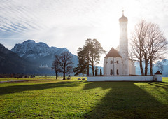 St Coloman Church (Philipp Klinger Photography) Tags: trip travel autumn trees winter light shadow vacation sky sun mountain holiday snow alps tree green tower castle fall church nature grass wall architecture backlight clouds germany landscape bayern deutschland bavaria licht nikon europa europe shadows counter angle wide meadow wideangle palace hills alpen neuschwanstein philipp sankt gegenlicht hohenschwangau d800 allgu schwangau counterlight klinger stcoloman ostallgu coloman sanktcoloman